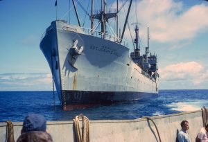 USNS Sgt Jonah E. Kelley (T-APC-116) anchored off Easter Island in December 1966.